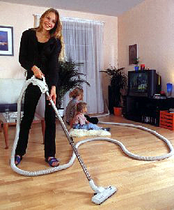 hoovering at house
